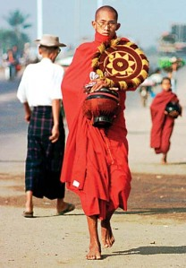 buddhist-monk-on-the-way-in-bago-myanmar-burma-to-get-food-into-the-bowl